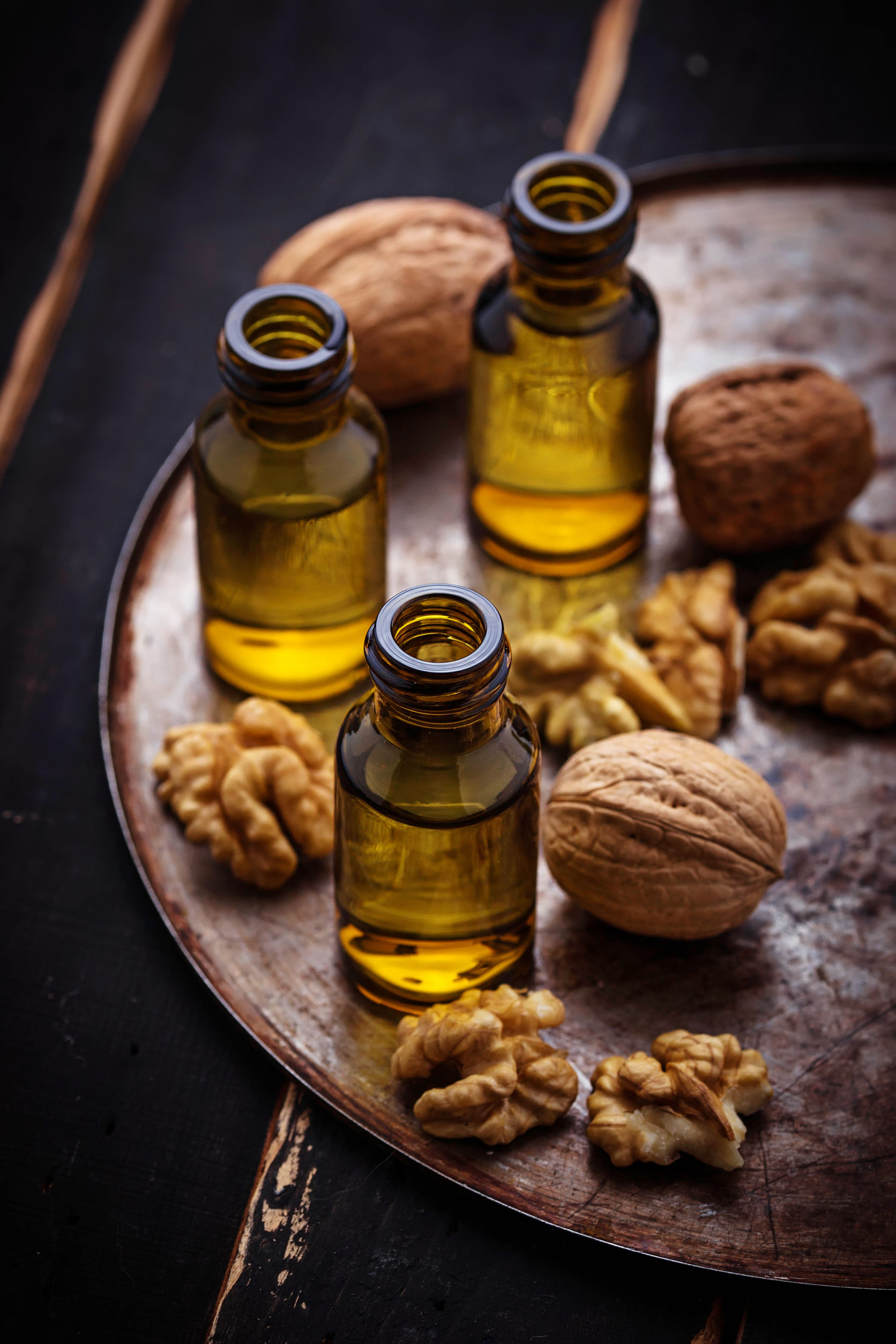 53059475 - walnuts oil in small bottles. selective focus